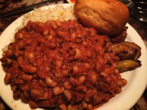 Kone ni Makondo - Black-eyed peas in onion and tomato stew served with coconut rice and fried ripe plantains